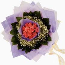 12 adet gül ve elyaflardan   Diyarbakır güvenli kaliteli hızlı çiçek