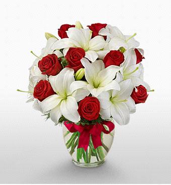 Diyarbakır kaliteli taze ve ucuz çiçekler  1 dal kazablanka 11 adet kırmızı gül vazosu